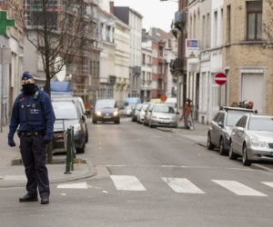 2016-03-19 07:39:54 A policeman patrols Molenbeek's neighbourhood in Brussels on March 19, 2016. Key Paris attacks suspect Salah Abdeslam and an accomplice on March 19, 2016 left the Brussels hospital where they were treated overnight for gunshot wounds sustained during their arrest, the city mayor said. Both are likely to be questioned before a hearing on their extradition to France in connection with the November attacks on Paris which left 130 people dead.Abdeslam, 26, and four other suspects were arrested on Friday in the gritty Brussels neighbourhood of Molenbeek. AFP PHOTO / THIERRY MONASSE