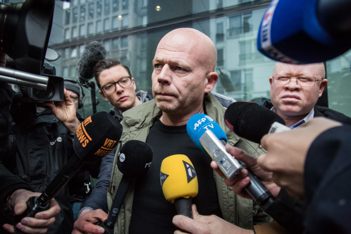 2016-03-19 14:04:04 Sven Mary, Belgian lawyer of Paris attacks suspect Salah Abdeslam, talks to the media outside the building of the Federal Police in Brussels, on March 19, 2016. Top Paris attacks suspect Salah Abdeslam, who was captured in a dramatic raid in Brussels, was to be questioned by Belgian police on March 19, 2016 ahead of his speedy transfer to France. Following his release from hospital where he was treated for a slight gunshot wound to the leg sustained during his arrest, Abdeslam was to be quizzed over his role in the November 13 massacre which killed 130 people and was claimed by the Islamic State (IS) group. / AFP PHOTO / Belga / Aurore Belot / Belgium OUT