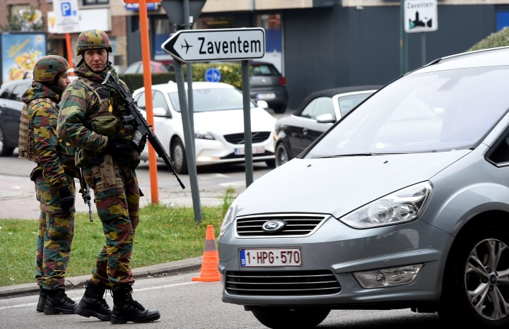 2016-03-24 10:55:27 Belgian troops man a checkpoint outside Brussels airport in Zaventem on March 24, 2016, two days after terror attacks in the Belgian capital. Police in Brussels ramped up a desperate hunt for a fourth man suspected of taking part in the Islamic State bombings that struck at the very heart of Europe. Flags in the shellshocked city of Brussels hung at half-mast as Belgium mourned the 31 people from all over the world killed in the attacks, while doctors battled to save scores more injured in the carnage. / AFP PHOTO / PATRIK STOLLARZ