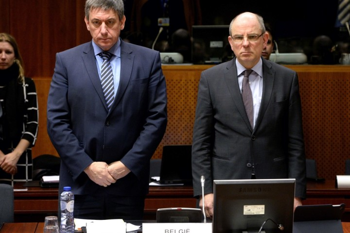 2016-03-24 00:00:00 Belgian Vice-Prime Minister and Interior Minister Jan Jambon (L) and Belgian Minister of Justice Koen Geens (L) observe a minute of silence during an 'Extraordinary meeting of ministers for Justice and Security and representatives of the EU institutions' at the European Council headquarters in Brussels, on March 24, 2016, two days after a triple bomb attack, claimed by the Islamic State group, hit Brussels' airport and the Maelbeek - Maalbeek metro station, killing 31 people and wounding 270 others. Belgian authorities are seeking a second suspect over the attack on a metro train in Brussels in which one suicide bomber has already been confirmed dead, police sources told AFP on March 24. / AFP PHOTO / Belga / ERIC LALMAND / Belgium OUT