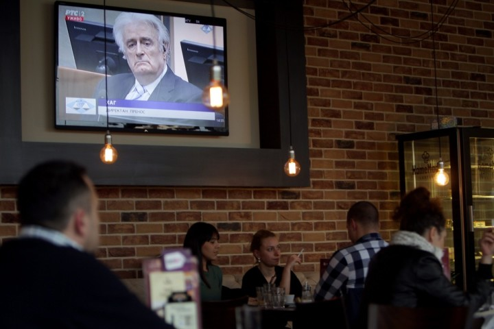 2016-03-24 14:33:13 epa05229118 Belgraders in a bar watch a television broadcast of United Nations war crimes tribunal passing judgment to former Bosnian Serb leader Radovan Karadzic, in Belgrade, Serbia. 24 March 2016. The United Nations International Criminal Tribunal for the former Yugoslavia (ICTY) is scheduled to announce a verdict on former Bosnian-Serbs leader Radovan Karadzic who is indicted for genocide, crimes against humanity, and war crimes. Karadzic is considered the main responsible for the Srebrenica massacre of July 1995. EPA/KOCA SULEJMANOVIC