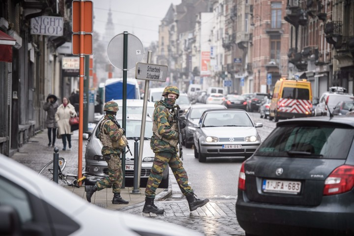2016-03-23 09:49:20 epa05226940 Belgian soldiers patrol in the Schaarbeek district of Brussels, Belgium, on 23 March 2016. Security services are on high alert following two explosions in the departure hall of Zaventem Airport and on the metro system in Brussels, Belgium, on 22 March 2016 where many people have died or been injured. Islamic State (IS) has since claimed responsibility for the attacks. EPA/CHRISTOPHE PETIT TESSON