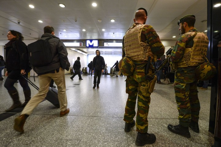 2015-11-18 00:00:00 Military police patrol the Brussels-South (Brussel Zuid/Midi) train station in Brussels on November 18, 2015. The national security level has been raised to three, after several terrorist attacks in Paris on November 13 left 129 dead and more than 350 injured. AFP PHOTO / BELGA / DIRK WAEM --BELGIUM OUT--