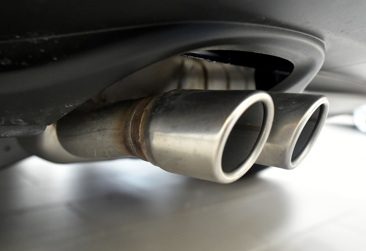 """2016-03-24 12:09:05 Exhaust pipes are seen on a Volkswagen vehicle at an auto dealership in San Francisco, California on March 24, 2016. US judge on Thursday gave Volkswagen until April 21 to come up with a plan to fix some 600,000 cars spewing illegal levels of pollutants due to emissions-cheating software. """"This issue of what is to be done with these cars must be done by that date,"""" US District Court Judge Charles Breyer told attorneys of the German automaker during a status hearing. / AFP PHOTO / Josh Edelson"""
