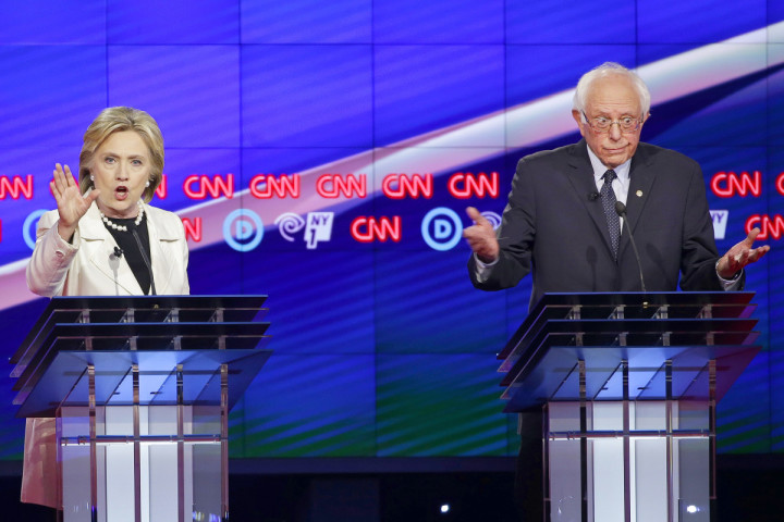 Democratic presidential candidates Sen. Bernie Sanders, I-V.t, right, and Hillary Clinton react as they speak during the CNN Democratic Presidential Primary Debate at the Brooklyn Navy Yard Thursday, April 14, 2016, New York. (AP Photo/Seth Wenig)