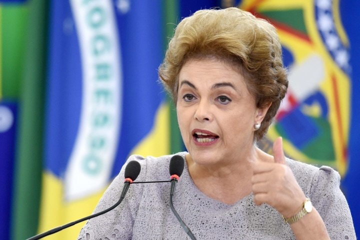 2016-03-22 14:04:04 Brazilian President Dilma Rousseff delivers a speech during meeting with a group of jurists and lawyers who came to the Planalto Palace in Brasilia to provide support in March 22, 2016. Brazilian lawmakers relaunched impeachment proceedings against Rousseff and a judge blocked her bid to bring her powerful predecessor Luiz Inacio Lula da Silva into her cabinet, intensifying the political crisis engulfing her government. AFP PHOTO/ANDRESSA ANHOLETE ANDRESSA ANHOLETE / AFP