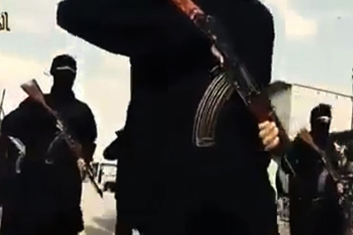 2014-09-23 08:22:58 An image grab taken from a video released by Islamic State group's official Al-Raqqa site via YouTube on September 23, 2014, allegedly shows Islamic State (IS) group recruits marching in an unknown location. The US-led coalition launched strikes against Islamic State militants besieging a Kurdish town in Syria as world leaders prepared for talks on September 24, 2014 at the UN on battling IS. AFP PHOTO/HO/ Islamic State group's Al-Raqqa site EDITORS NOTE: These images were obtained on September 23, 2014 from YouTube on the Islamic State group's official media site, in a video posted for propaganda purposes. == RESTRICTED TO EDITORIAL USE - NO MARKETING NO ADVERTISING CAMPAIGNS - DISTRIBUTED AS A SERVICE TO CLIENTS FROM ALTERNATIVE SOURCES, AFP IS NOT RESPONSIBLE FOR ANY DIGITAL ALTERATIONS TO THE PICTURE'S EDITORIAL CONTENT, DATE AND LOCATION WHICH CANNOT BE INDEPENDENTLY VERIFIED ==