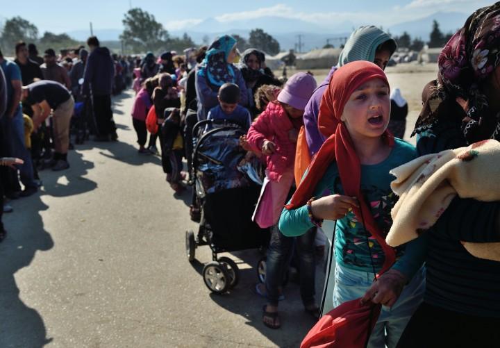 Archiefbeeld van migranten in het Griekse vluchtelingenkamp bij Idomeni, vlakbij de grens met Macedonië - Foto: AFP