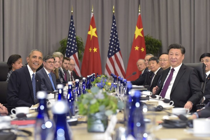 2016-03-31 18:23:27 US President Barack Obama and China's President Xi Jinping ( R) take part in a bilateral meeting on the sidelines of the Nuclear Security Summit at the Walter E. Washington Convention Center on March 31, 2016 in Washington, DC. / AFP PHOTO / MANDEL NGAN