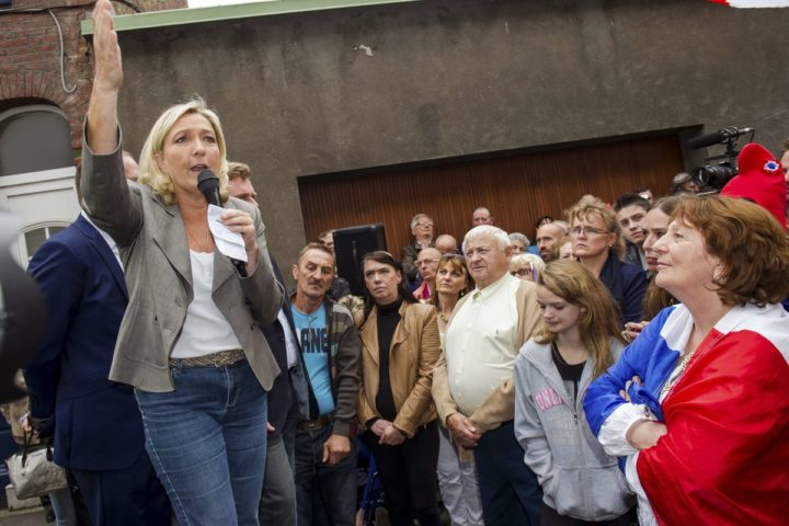 2014-09-14 15:00:04 French far-right Front National party's president Marine le Pen (L) makes a speech during the inauguration of a sidewalk sale in Henin-Beaumont, northern France, on September 14, 2014. AFP PHOTO PHILIPPE HUGUEN