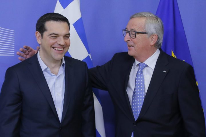 epa05166563 Greek Prime Minister Alexis Tsipras (L) is welcomed by European Commission President Jean-Claude Juncker (R) prior to their meeting at the EU Commission in Brussels, Belgium, 17 February 2016. EPA/OLIVIER HOSLET