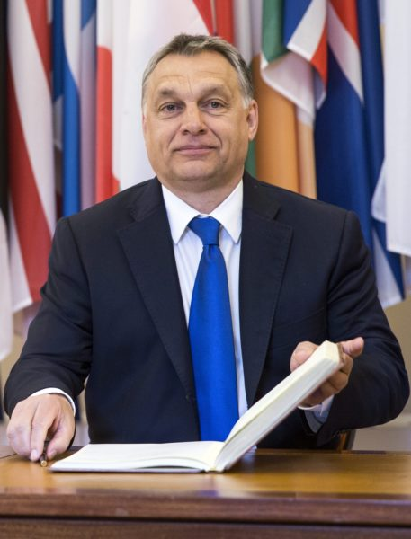 2016-04-07 00:00:00 epa05247229 Hungarian Prime Minister Viktor Orban signs the golden book prior to a meeting with General Secretary of the 'Organisation for Economic Co-operation and Development (OECD)' Jose Angel Gurria (not pictured) at the organization headquarters in Paris, France, 07 April 2016. Orban is to address on Hungary being 20 years member of the OECD. EPA/ETIENNE LAURENT