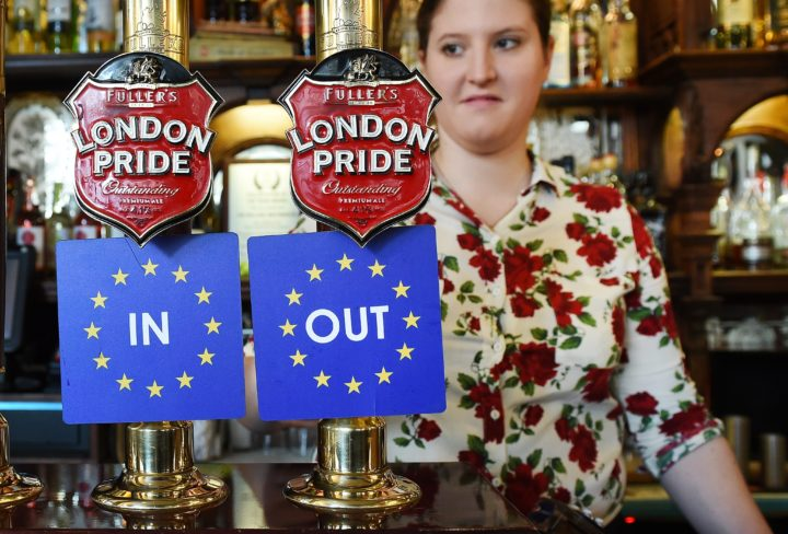 2016-04-15 10:33:41 epa05259830 EU IN OUT bar coasters are pinned to ale taps at a pub in Westminster, London, Britain, 15 April 2016. The EU referendum campaign officially kicked off the same day with the 'Britain Stronger in Europe' and 'Vote Leave' to begin criss crossing the UK in order to get their message to the voters. Britain will vote on 23 June 2016 wether to remain in the EU or to leave. EPA/ANDY RAIN