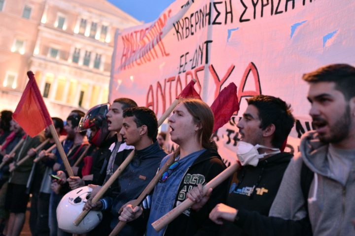 Young people shout slogans during a protest rally against the latest reform measures demanded by Greece's creditors, in front of the Greek parliament building in Athens on May 8, 2016. The reforms to be voted on by MPs later on May 8 would reduce Greece's highest pension payouts, merge several pension funds, increase contributions and raise taxes for those on medium and high incomes. / AFP PHOTO / LOUISA GOULIAMAKI