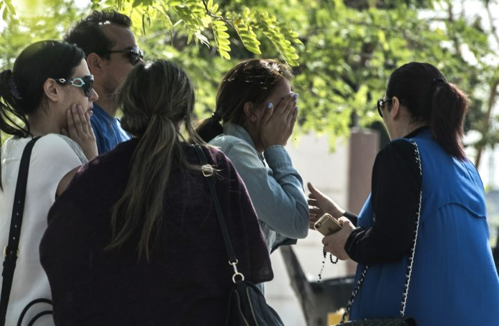 2016-05-19 23:29:44 Families of passengers who were flying in an EgyptAir plane that vanished from radar en route from Paris to Cairo react as they wait outside a services hall at Cairo airport on May 19, 2016. The EgyptAir flight that vanished over the Mediterranean was carrying 30 Egyptian and 15 French passengers, as well as a Briton and a Canadian, the airline said. / AFP PHOTO / KHALED DESOUKI