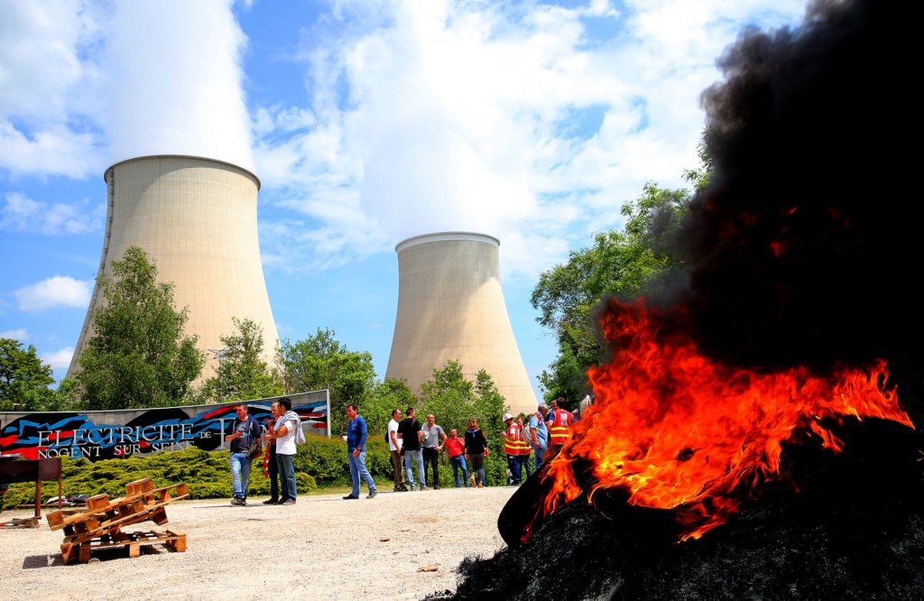 2016-05-26 14:11:56 Workers block the access to the nuclear power plant of Nogent-sur-Seine on May 26, 2016, during a protest against controversial labour market reforms that has already severely disrupted fuel supplies. With two weeks until France hosts the Euro 2016 football championships, the country has been paralysed by a series of transport strikes and fuel shortages that has heaped pressure on the deeply unpopular Socialist government. / AFP PHOTO / FRANCOIS NASCIMBENI