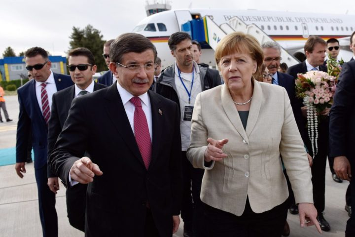 2016-04-23 00:00:00 epa05273710 A handout picture provided by the German Federal Government shows German Chancellor Angela Merkel (R) as she is greeted by the Turkish Prime Minister Ahmet Davutoglu (L) upon her arrival at Gaziantep Airport in Gaziantep, Turkey, 23 April 2016. Merkel travelled to Turkey with the President of the European Council, Donald Tusk, to get informed about the implementation of the EU-Turkey Refugee Agreement. EPA/STEFFEN KUGLER/GERMAN FEDERAL GOVERNMENT/HANDOUT MANDATORY CREDIT: STEFFEN KUGLER/GERMAN FEDERAL GOVERNMENT HANDOUT EDITORIAL USE ONLY/NO SALES
