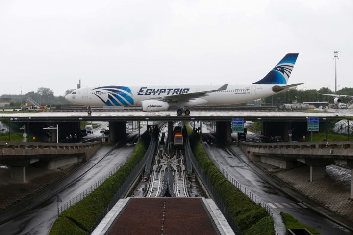 2016-05-19 12:16:09 This picture taken on May 19, 2016, shows an Egyptair Airbus A330 from Cairo taxiing at the Roissy-Charles De Gaulle airport near Paris after its landing a few hours after the MS804 Egyptair flight crashed into the Mediterranean. An EgyptAir flight from Paris to Cairo crashed into the Mediterranean on May 19, 2016, with 66 people on board, prompting an investigation into whether it was mechanical failure or a bomb. There were no immediate reports of the discovery of any debris in the area of sea between the Greek islands and the Egyptian coast where the plane vanished from radar screens. / AFP PHOTO / THOMAS SAMSON