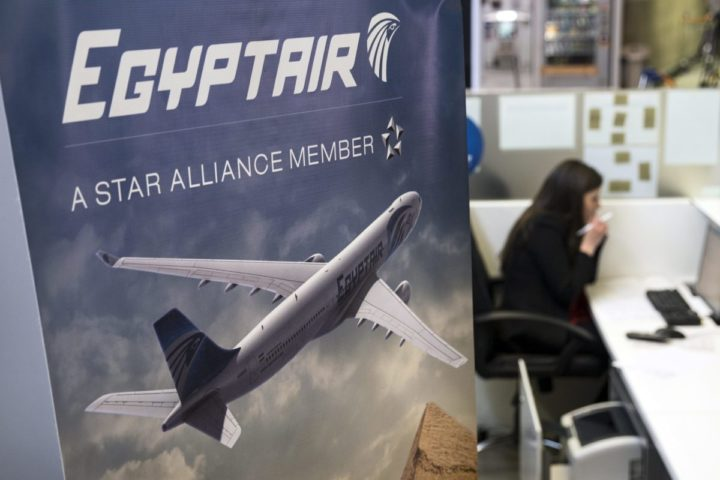 2016-05-19 12:11:03 epa05316517 A hostess talks on the phone next to the Egyptair's desk at the Charles de Gaule airport near Paris, France, 19 May 2016. According to media reports quoting Egyptair on 19 May 2016, EgyptAir Airbus A320 Flight MS804 disappeared off radar some 10 miles (16km) after entering Egypt's airspace. The plane, said to be carrying 69 people on board, 59 passengers and 10 crew members, took off from France's Charles de Gaulle airport on 18 May night and was expected to land in Cairo on 19 May early morning. EPA/ETIENNE LAURENT