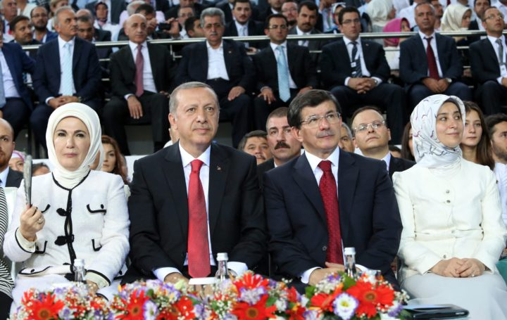 2014-03-05 00:00:00 epa04370901 Emine Erdogan (L-R), Turkish President- elect Recep Tayyip Erdogan, Turkish Foreign Minister Ahmet Davutoglu and wife Sare Davutoglu during a congress of Turkey's ruling Party AKP for the election of a new new Prime Minister in Ankara, Turkey, 27 August 2014. Foreign Minister Ahmet Davutoglu is the new party chairman of Turkey's ruling Justice and Development Party (AKP) after a vote at a special conference, clearing his way to take over as prime minister. The AKP chose Davutoglu - the sole candidate, and regarded as a follower of Prime Minister and president-elect Recep Tayyip Erdogan - by an overwhelming majority. EPA/RASIT AYDOGAN / POOL