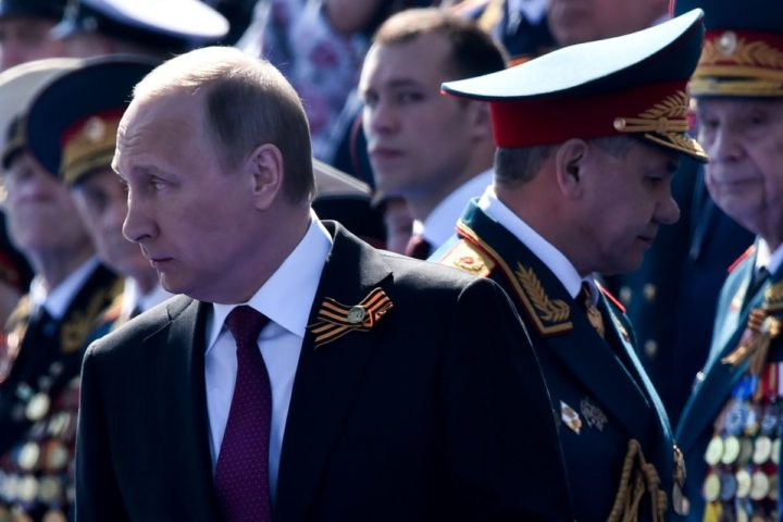 2016-05-09 07:13:39 Russian President Vladimir Putin (L) and Defence Minister Sergei Shoigu attend the Victory Day military parade at Red Square in Moscow on May 9, 2016. Russia marks the 71st anniversary of the Soviet Union's victory over Nazi Germany in World War II. / AFP PHOTO / KIRILL KUDRYAVTSEV