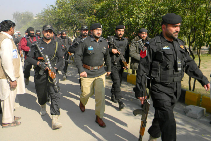 (160120) -- CHARSADDA, Jan. 20, 2016 (Xinhua) -- Pakistani policemen enter Bacha Khan University following an attack by gunmen in northwest Pakistan's Charsadda, Jan. 20, 2016. A splinter group of Tehreek-e-Taliban Pakistan (TTP) on Wednesday claimed responsibility for the attack on a university in the country's northwest district of Charsadda, which has reportedly killed 19 people and wounded over 50 others. (Xinhua/Ahmad Sidique) ****Authorized by ytfs**** Xinhua News Agency / eyevine Contact eyevine for more information about using this image: T: +44 (0) 20 8709 8709 E: info@eyevine.com http://www.eyevine.com