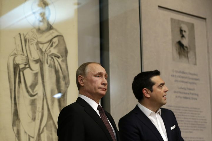 2016-05-27 23:42:19 epa05332949 Greek Prime Minister Alexis Tsipras (R) with Russian President Vladimir Putin (L) visit the Byzantine and Christian museum in Athens, Greece, 27 May 2016. Russian President Vladimir Putin has traveled to Greece to visit a secluded Christian Orthodox monastic sanctuary and discuss energy and privatization deals in the cash-strapped country.  EPA/Thanassis Stavrakis/ POOL