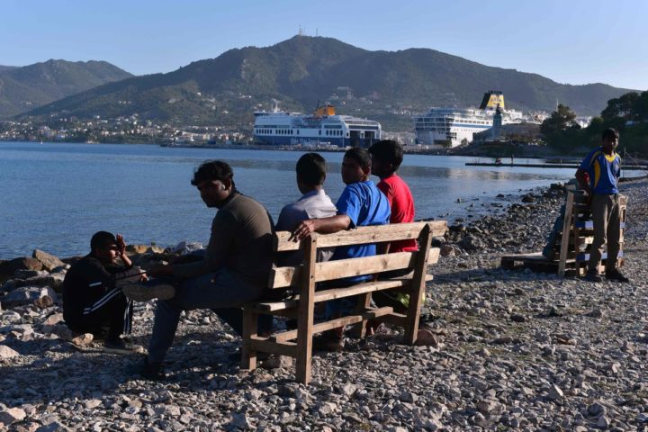2016-04-15 18:17:37 Pakistani migrants sit at a makeshift camp staged near the port of Mytilene on the Greek island of Lesbos on April 15, 2016. Pope Francis was urged on April 14, 2016 to speak out against the European Union's deal to send migrants back to Turkey when he visits Lesbos, the Greek island on the frontline of the crisis, His five-hour stay will include a visit to a centre for processing asylum seekers which rights groups says has become a detention facility under the terms of a controversial EU-Turkey accord that came into force last month. / AFP PHOTO / LOUISA GOULIAMAKI