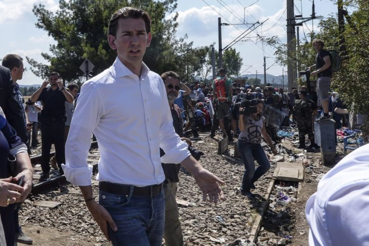 2015-08-24 12:18:47 epa04896034 Austrian Foreign Minster Sebastian Kurz during his visit to the border between Macedonia and Greece where migrants are waiting for permission to cross into Macedonia, near the southern city of Gevgelija, The Former Yugoslav Republic of Macedonia, 24 August 2015. They also visited a new reception camp for migrants. From the beginning of the year to mid-June 2015, nearly 160,000 migrants landed in the southern European countries, mainly Greece and Italy, on their way to wealthier countries in Western and Northern Europe, according to estimates by the International Organization for Migration (IOM). EPA/GEORGI LICOVSKI