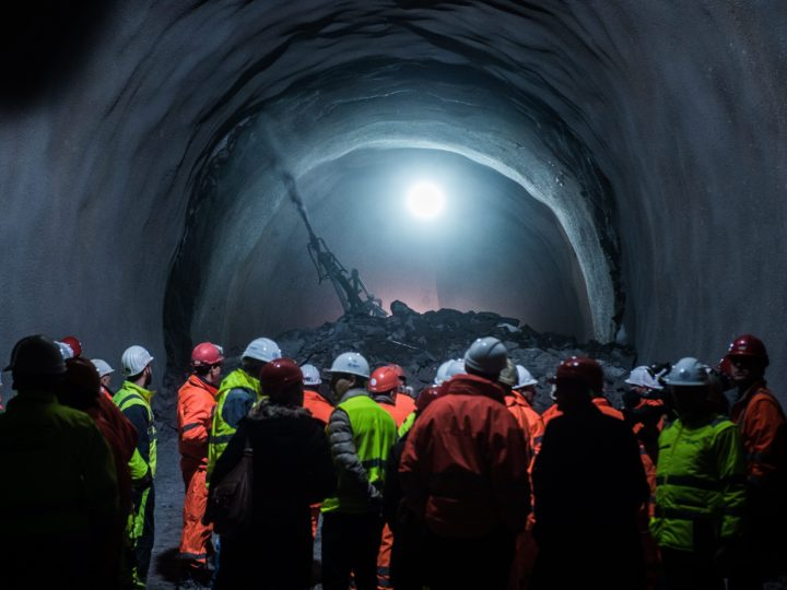 2016-01-21 00:00:00 epa05116011 Miners celebrate after the blasting breakthrough of Ceneri Base Tunnel in Camorino-Vigano, Canton of Ticino, southern Switzerland, 21 January 2016. The 15.4-kilometers-long Ceneri Base Tunnel is Switzerland's second largest tunnel-construction project. It passes under the Monte Ceneri Mountain and links Camorino (north) and Vezia (south). Together with the Gotthard Base Tunnel which opens 2016, it forms the heart of the 'New Railway Link through the Alps NRLA'. The two Base Tunnel create a continuous flat north-south route. The Ceneri Base Tunnel is scheduled to be opened and become operational in 2020. EPA/SAMUEL GOLAY