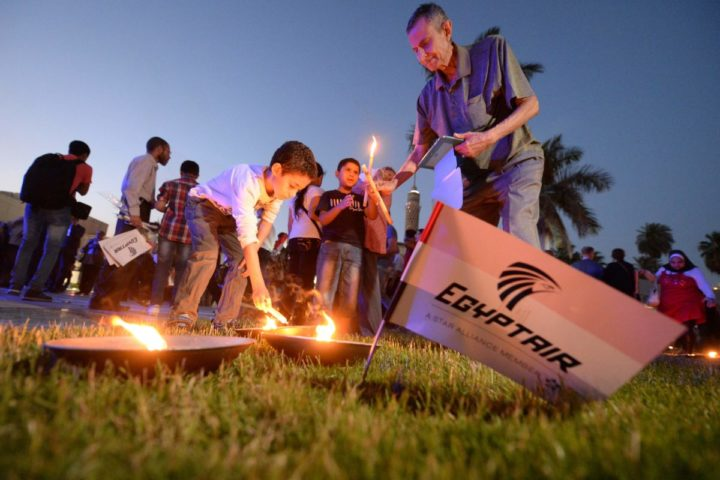 2016-05-26 17:15:47 Egyptians light candles during a candlelight vigil for the 66 victims of the EgyptAir MS804 flight that crashed in the Mediterranean Sea, at the Cairo Opera House in the Egyptian capital on May 26, 2016. Investigators are still searching for the Airbus A320's two black boxes on the seabed as they seek answers as to why the aircraft came down early on May 19, with 66 people on board. / AFP PHOTO / KHALED DESOUKI