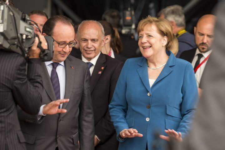2016-06-01 11:51:52 epa05340591 (L-R) French President Francois Hollande, Swiss federal Councillor Ueli Maurer and German Chancellor Angela Merkel during the opening day of the Gotthard rail tunnel, the longest tunnel in the world, at the southern portal in Pollegio, Switzerland, 01 June 2016. The construction of the 57 kilometer long tunnel began in 1999, the breakthrough was in 2010. After the official opening on 01 June, the commercial opperation will commence in December 2016. EPA/ALEXANDRA WEY