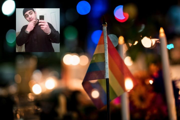 2016-06-13 00:00:00 A gay pride flag is seen at a memorial after a vigil outside the Dr. Phillips Center for the Performing Arts for the mass shooting victims at the Pulse nightclub June 13, 2016 in Orlando, Florida. The American gunman who launched a murderous assault on a gay nightclub in Orlando was radicalized by Islamist propaganda, officials said Monday, as they grappled with the worst terror attack on US soil since 9/11. / AFP PHOTO / Brendan Smialowski