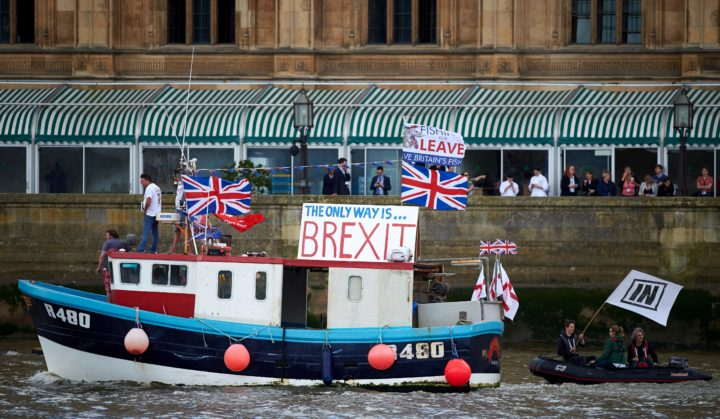 "2016-06-15 12:34:03 A boat decorated with flags and banners from the 'Fishing for Leave' group that are campaigning for a 'leave' vote in the EU referendum sails by the British Houses of Parliament as part of a ""Brexit flotilla' on the river Thames in London on June 15, 2016. A Brexit flotilla of fishing boats sailed up the River Thames into London today with foghorns sounding, in a protest against EU fishing quotas by the campaign for Britain to leave the European Union. / AFP PHOTO / NIKLAS HALLE'N"