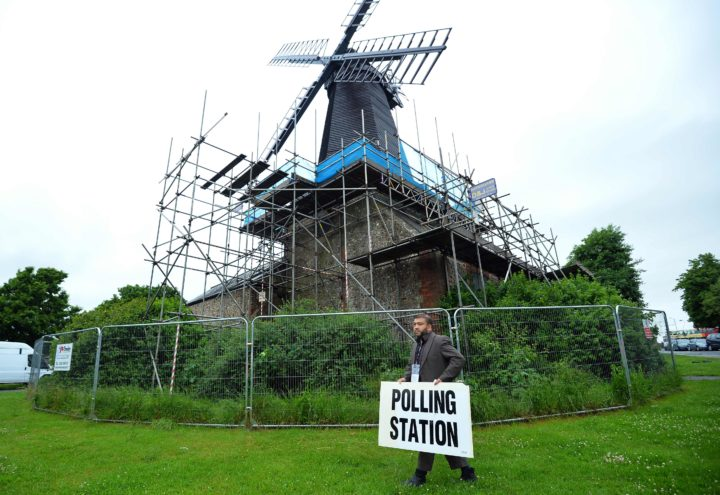 2016-06-23 06:34:02 Presiding officer Ahmed Z Jamee prepares to open the polling station at West Blatchington Windmill near Brighton, in southern England on June 23, 2016, as Britain holds a referendum on wether to stay or leave the European Union (EU). Millions of Britons began voting Thursday in a bitterly-fought, knife-edge referendum that could tear up the island nation's EU membership and spark the greatest emergency of the bloc's 60-year history. / AFP PHOTO / GLYN KIRK