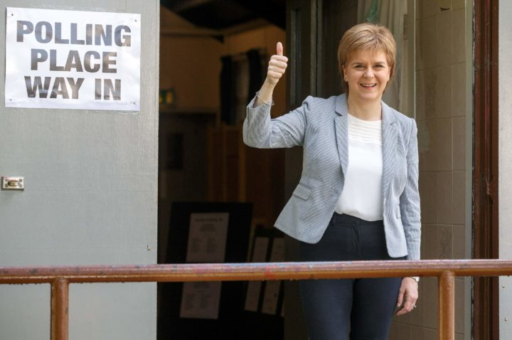 2016-06-23 08:03:40 Scotland's First Minister and Leader of the Scottish National Party (SNP), Nicola Sturgeon, poses for photographers as leaves after voting at a polling station at Broomhouse Community Hall in east Glasgow, on June 23, 2016, as Britain holds a referendum on whether to stay or leave the European Union (EU). Millions of Britons began voting Thursday in a bitterly-fought, knife-edge referendum that could tear up the island nation's EU membership and spark the greatest emergency of the bloc's 60-year history. / AFP PHOTO / Robert Perry
