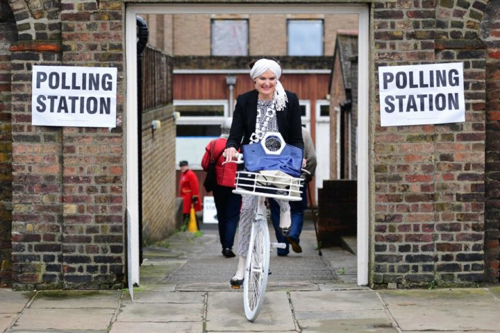 2016-06-23 10:58:16 A woman rides a bicycle as she leaves a polling station at the Royal Hospital in Chelsea, west London on June 23, 2016, as Britain holds a referendum to vote on whether to remain in, or to leave the European Union (EU). Millions of Britons began voting Thursday in a bitterly-fought, knife-edge referendum that could tear up the island nation's EU membership and spark the greatest emergency of the bloc's 60-year history. / AFP PHOTO / LEON NEAL