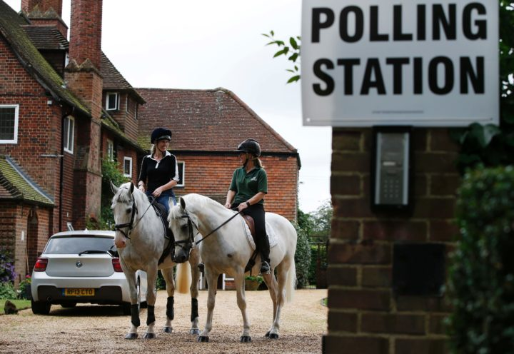 2016-06-23 11:41:37 Jacqui Vaughan (L) and Sophie Allison, riding horses Splash and Sharna, ride out of the driveway of a private residence, used as a polling station, near Reading, west of London, on June 23, 2016, as Britain holds a referendum to vote on whether to remain in, or to leave the European Union (EU). The rural house where Allison runs her livery business has been a polling station for the local residents for more than 40 years. Millions of Britons began voting Thursday in a bitterly-fought, knife-edge referendum that could tear up the island nation's EU membership and spark the greatest emergency of the bloc's 60-year history. / AFP PHOTO / ADRIAN DENNIS