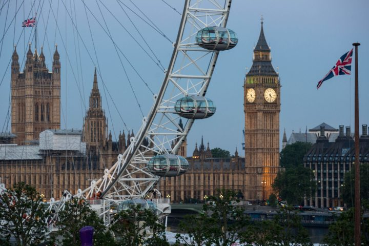 2016-06-24 04:30:04 A Union flag flies beside the London Eye in front of the Queen Elizabeth Tower (Big Ben) and The Houses of Parliament in London on June 24, 2016. Britain's economy was plunged into a dizzying unknown on Friday as the country lurched towards the EU exit, with the world economy bracing for a hit on growth and unemployment. / AFP PHOTO / POOL / ROB STOTHARD
