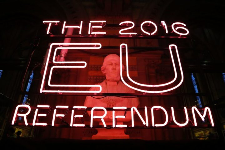 2016-06-24 05:25:04 A neon sign for the 2016 referendum is attached to the doors of the announcement hall in Manchester Town Hall , northwest England on June 23, 2016 where the final result of a referendum on whether the UK will remain or stay in the European Union (EU) will be announced. Britain has voted to leave the European Union by 52 percent to 48 percent, the BBC reported on Friday, after nearly all the results had been counted. / AFP PHOTO / POOL / Rob Stothard