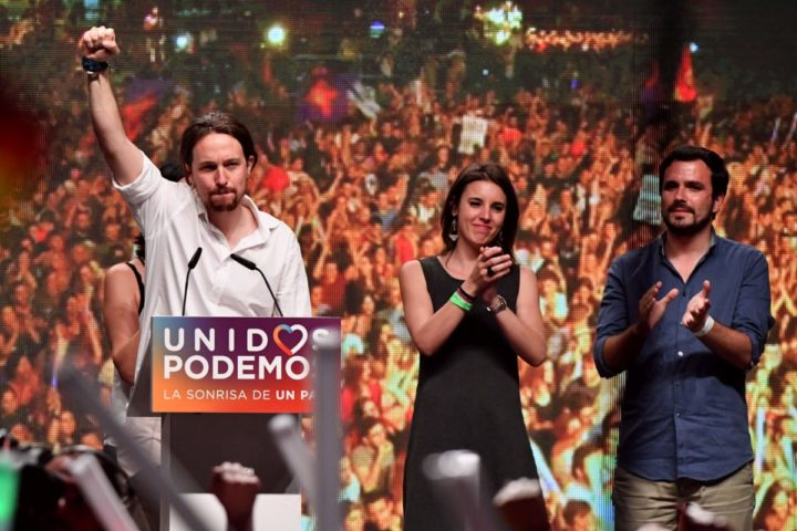 2016-06-26 22:46:58 Leader of left wing party Podemos and party candidate, Pablo Iglesias (L) raises his fist past Left-wing Podemos member and Madrid candidate congress the general election Irene Montero (C) and Left-wing party IU leader Alberto Garzon official following the results at Reina Sofia square during Spain's general elections in Madrid on June 26, 2016. Spain's repeat polls ended on June 26 with the incumbent conservatives appearing to have scored a small win tailed closely by a far-left coalition led by Podemos, exit polls said, against a backdrop of record/low abstention. / AFP PHOTO / GERARD JULIEN