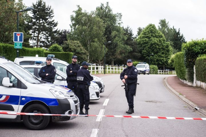 2016-06-14 00:00:00 epa05363448 Police officers stand guard at a security perimeter near a house where a French police officer and his wife have been murdered by an assailant allegedly claimed as a ISIS fighter, in Magnanville, near Paris, France, 14 June 2016. The police officer was stabbed outside his house and his partner was killed by the hostage taker, late 13 June 2016. The attacker was killed during the police raid. EPA/CHRISTOPHE PETIT TESSON
