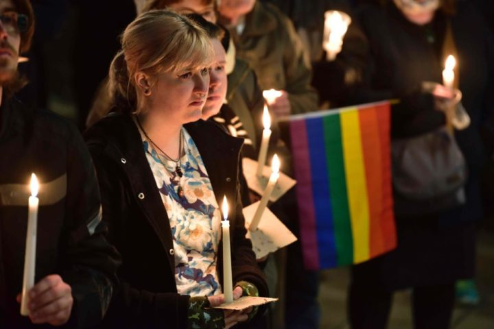 2016-06-13 06:26:41 Participants hold candles during a vigil at Frank Kits Park in Wellington on June 13, 2016, in remembrance of victims after a gunman opened fire in a gay nightclub in Orlando, Florida in the worst mass shooting in US history. US anti-terror strategy came under fresh scrutiny after a gunman previously cleared of jihadist ties launched a hate-fueled rampage in a Florida gay club that left 50 dead. / AFP PHOTO / Marty Melville
