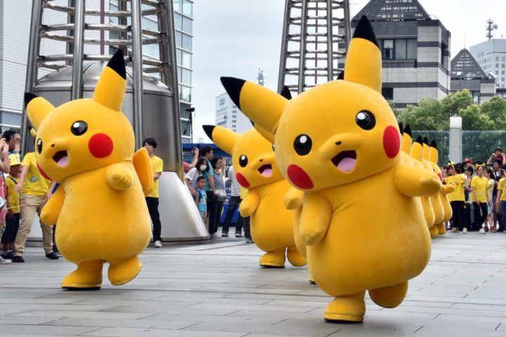 """2015-08-13 11:35:49 Dozens of Pikachu characters, the famous character of Nintendo's videogame software Pokemon, march at the Landmark Plaza shopping mall in Yokohama, suburban Tokyo on August 13, 2015. The Pikachu mascots walk around daily to attract summer vacationers as a part of the """"Pikachu Outbreak"""" event through the weekend. AFP PHOTO / Yoshikazu TSUNO"""