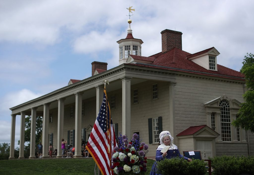 2016-06-02 00:00:00 MOUNT VERNON, VA - JUNE 2: Mary Wiseman, a historical interpreter who portrays Martha Washington, waits for the beginning of a naturalization ceremony June 2, 2016 at George Washington's Mount Vernon in Mount Vernon, Virginia. The Mount Vernon Ladies' Association and U.S. Citizenship and Immigration Service hosted a special naturalization ceremony to mark the 285th birthday of Martha Washington. Alex Wong/Getty Images/AFP == FOR NEWSPAPERS, INTERNET, TELCOS & TELEVISION USE ONLY ==