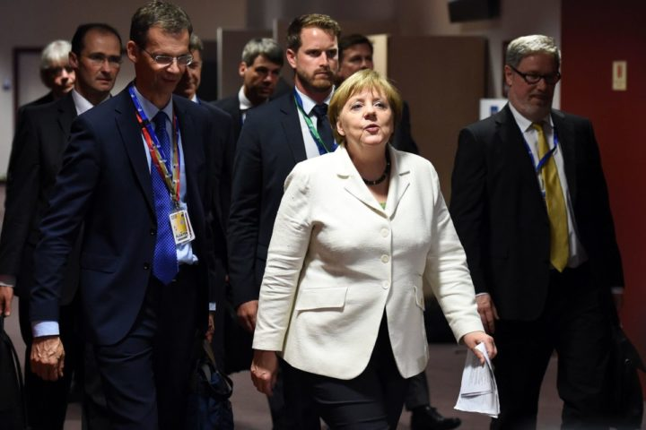 "Germany's Chancellor Angela Merkel arrives for a press conference during an EU summit meeting on June 28, 2016 at the European Union headquarters in Brussels. Prime Minister David Cameron said today he wants the ""closest possible"" relations with the EU after Britain voted to leave the bloc, adding the split should be ""as constructive as possible"". As he arrived at a Brussels summit, Cameron, who is to step down within weeks, told reporters that, while Britain was leaving the EU, ""we mustn't be turning our backs on Europe."" / AFP PHOTO / STEPHANE DE SAKUTIN"
