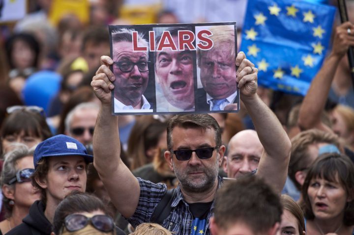 2016-07-02 12:16:08 A woman holds up a placard depicting Michael Gove, Nigel Farage and Boris Johnson as liars as thousands of protesters take part in a March for Europe, through the centre of London on July 2, 2016, to protest against Britain's vote to leave the EU, which has plunged the government into political turmoil and left the country deeply polarised. Protesters from a variety of movements march from Park Lane to Parliament Square to show solidarity with those looking to create a more positive, inclusive kinder Britain in Europe. / AFP PHOTO / Niklas HALLE'N
