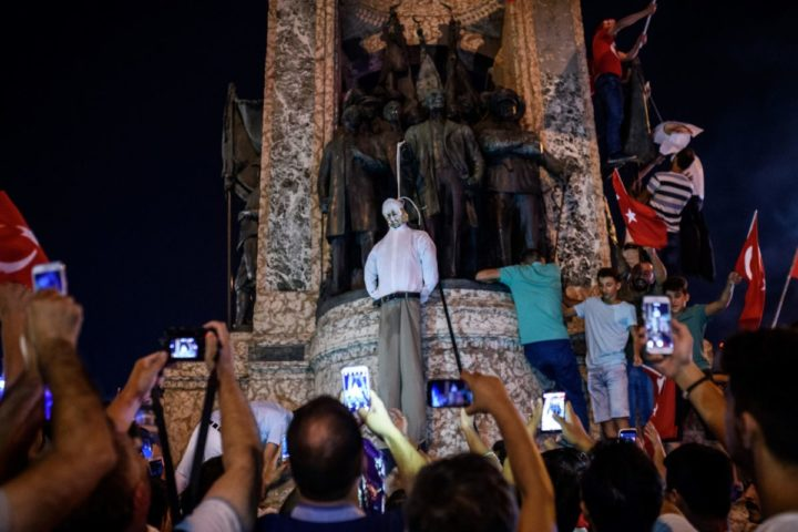 2016-07-18 20:52:12 Pro-Erdogan supporters hold an effigy of US-based preacher Fethullah Gulen hunged by a noose during a rally at Taksim square in Istanbul on July 18, 2016 following the military failed coup attempt of July 15. Turkish security forces on July 18 carried out new raids against suspected plotters of the botched coup against the rule of President Recep Tayyip Erdogan, as international concern grew over the scale of the crackdown. Thousands of pro-Erdogan supporters waving Turkish flags filled the main Kizilay Square in Ankara while similar scenes were seen in Taksim Square in Istanbul, AFP photographers said. / AFP PHOTO / OZAN KOSE