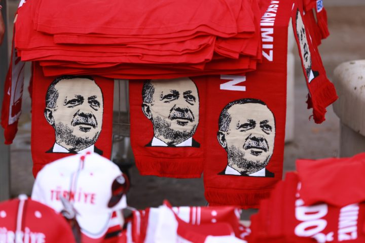 2016-07-25 18:18:24 This picture taken on July 25, 2016, shows scarves with the effigy of Turkish President Recep Tayyip Erdogan a rally against the military coup in Ankara. Turkish authorities on July 25 issued arrest warrants for over 40 journalists in a new phase of the controversial legal crackdown after the failed coup against President Recep Tayyip Erdogan, sparking fresh alarm over the scope of the detentions. / AFP PHOTO / ADEM ALTAN