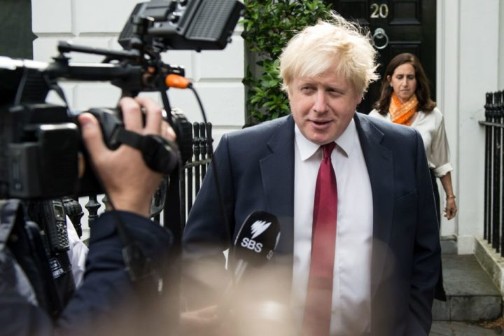 Former London Mayor Boris Johnson and his wife Marina (R) are pictured as they leave their home in London on June 30, 2016. Brexit campaigner Michael Gove announced a surprise bid Thursday to become Britain's next prime minister, in a blow for his close ally Boris Johnson's chances, as turmoil gripped both the country's main political parties after the shock vote to leave the EU. / AFP PHOTO / CHRIS J RATCLIFFE